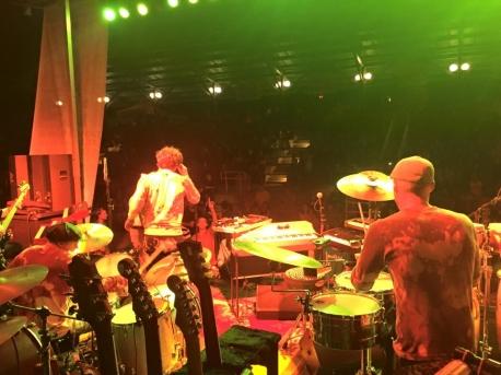 Downright at River Fete backstage shot orange